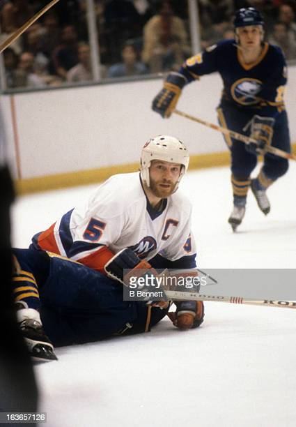 Denis Potvin of the New York Islanders battles with a player from the Buffalo Sabres during the 1980 Semi Finals in May 1980 at the Nassau Coliseum...