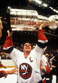 Denis Potvin of the New York Islanders celebrates with the Stanley Cup after defeating the Edmonton Oilers in Game 4 of the 1983 Stanley Cup Finals...
