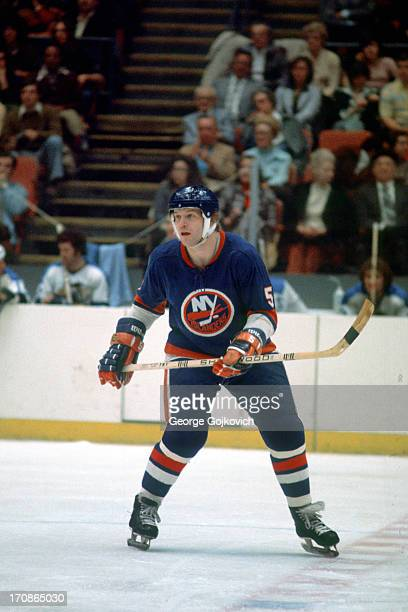 Denis Potvin of the New York Islanders looks on from the ice during a National Hockey League game against the Pittsburgh Penguins at the Civic Arena...