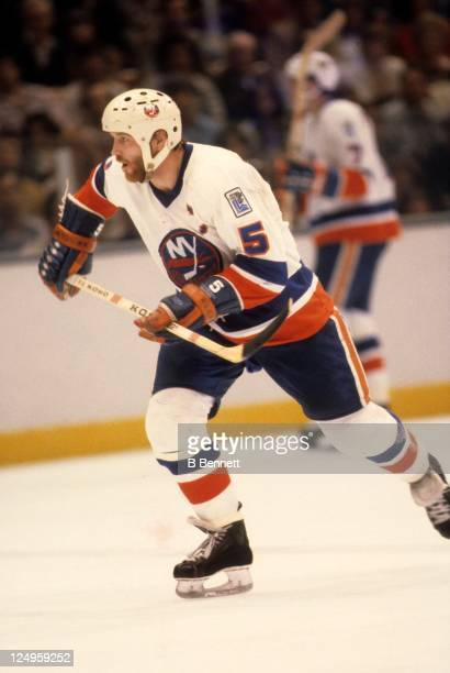 Denis Potvin of the New York Islanders skates on the ice during an NHL Playoff game in April 1980 at the Nassau Coliseum in Uniondale New York