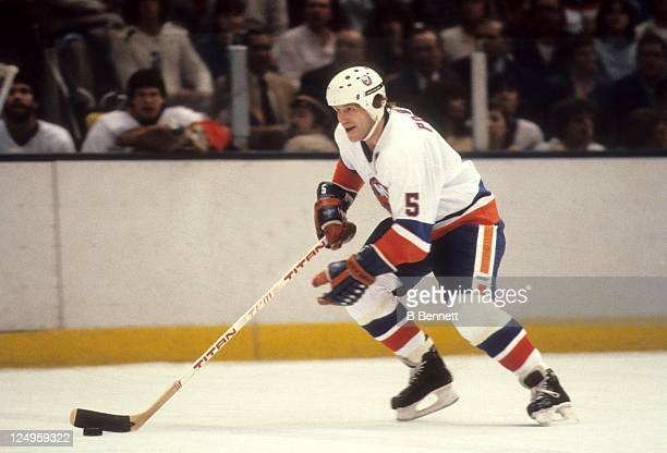 Denis Potvin of the New York Islanders skates with the puck during an NHL game circa 1980 at the Nassau Coliseum in Uniondale New York