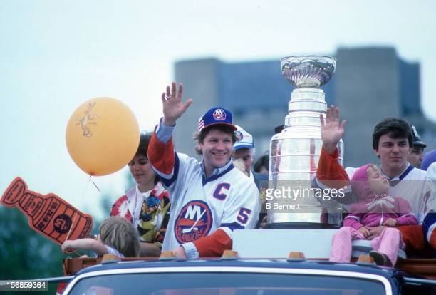 Denis Potvin of the New York Islanders waves to the crowd during the 1983 Stanley Cup Parade after they defeated the Edmonton Oilers on May 19 1983...
