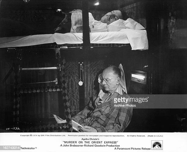 Denis Quilley lies awake while John Gielgud reads in a scene from the film 'Murder On The Orient Express' 1974