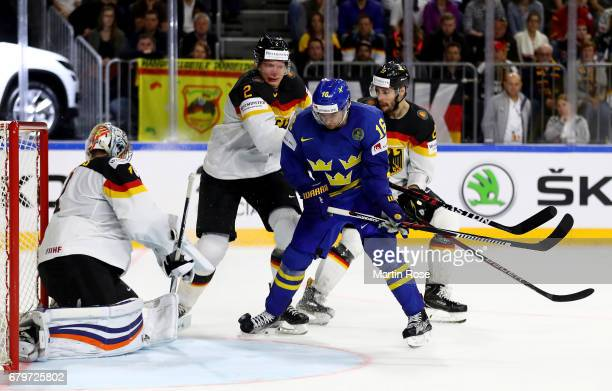 Denis Reul of Germany challenges Marcus Kruger of Sweden for the puck during the 2017 IIHF Ice Hockey World Championship game between Germany and...