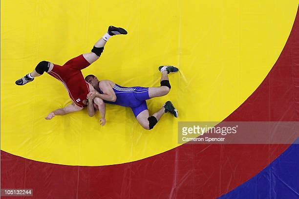 Denis Roberts of Australia competes against Mark Crocker of England in the men's 120kg freestyle final 35 wrestling at IG Sports Complex during day...