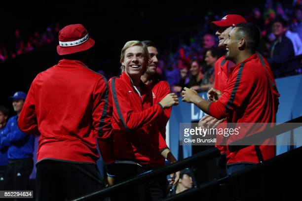Denis Shapovalov and Nick Kyrgios of Team World watch Rafael Nadal of Team Europe as he plays his singles match against Jack Sock of Team World on...