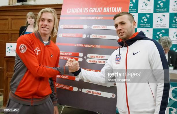 Denis Shapovalov if Canada and Dan Evans of Great Britain shake hands during the draw ceremony of the Davis Cup World Group tie between Great Britain...