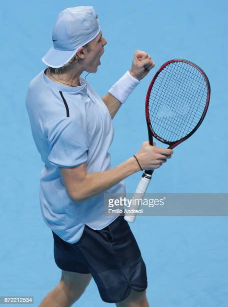 Denis Shapovalov of Canada celebrates after win a set in his match against Andrey Rublev of Russia during Day 3 of the Next Gen ATP Finals on...