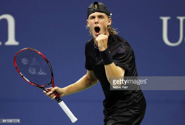 Denis Shapovalov of Canada celebrates defeating JoWilfried Tsonga of France during their second round Men's Second match on Day Three of the 2017 US...