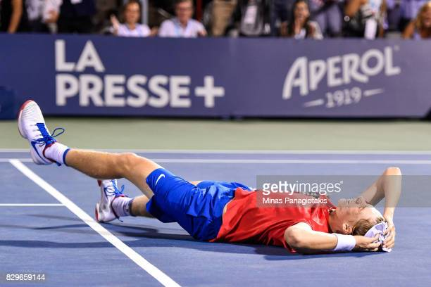 Denis Shapovalov of Canada falls to the ground after defeating Rafael Nadal of Spain during day seven of the Rogers Cup presented by National Bank at...