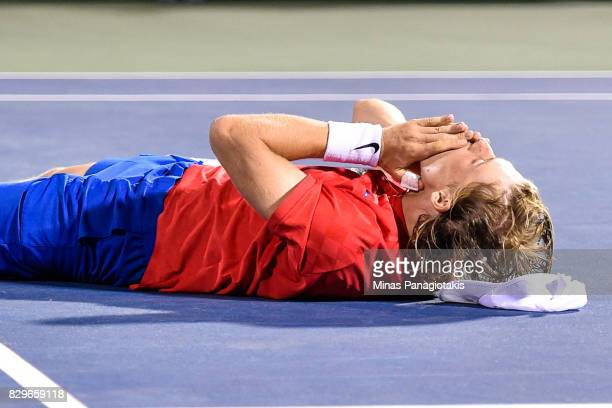 Denis Shapovalov of Canada falls to the ground after his victory over Rafael Nadal of Spain during day seven of the Rogers Cup presented by National...