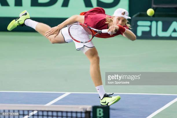 Denis Shapovalov of Canada fires a diving forehand back to Daniel Evans of Great Britain in the BNP Paribas Davis Cup Tennis Canada v Great Britain...