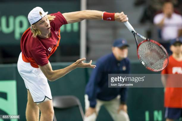 Denis Shapovalov of Canada follows through on a serve to Daniel Evans of Great Britain early in the first set of their singles match in the BNP...