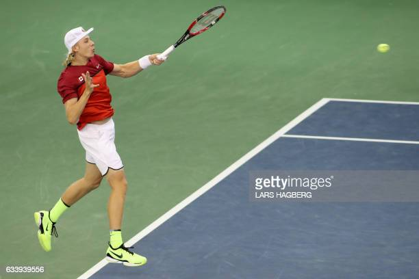 Denis Shapovalov of Canada hits a ball against Kyle Edmund of Great Britain during the first set on the third day of Davis Cup first round play...
