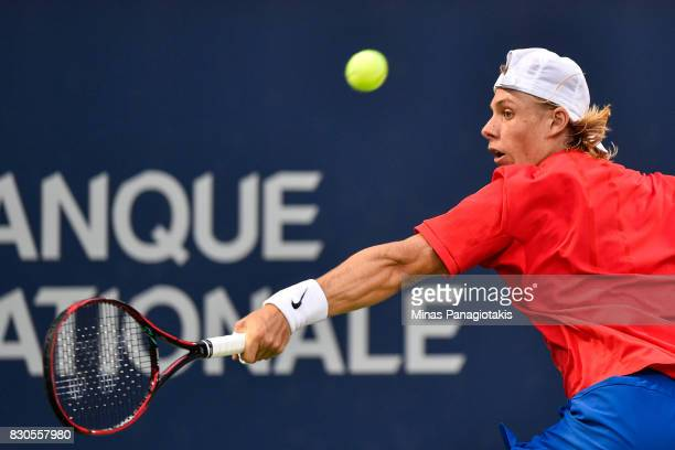 Denis Shapovalov of Canada hits a return against Adrian Mannarino of France during day eight of the Rogers Cup presented by National Bank at Uniprix...