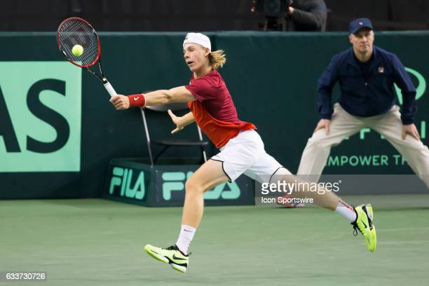 Denis Shapovalov of Canada of Canada reaches to return a shot from Daniel Evans of Great Britain in the BNP Paribas Davis Cup Tennis Canada v Great...