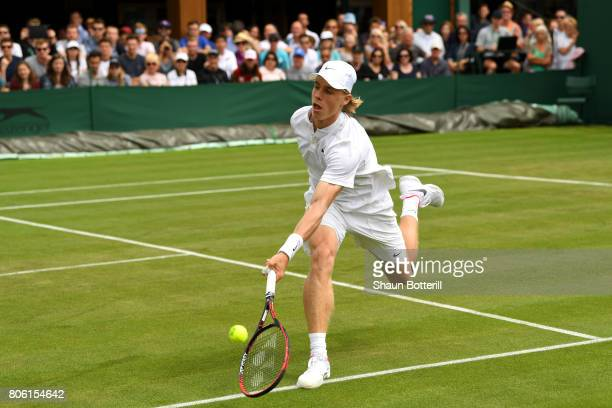 Denis Shapovalov of Canada plays a forehand during the Gentlemen's Singles first round match against Jerzy Janowicz of Poland on day one of the...