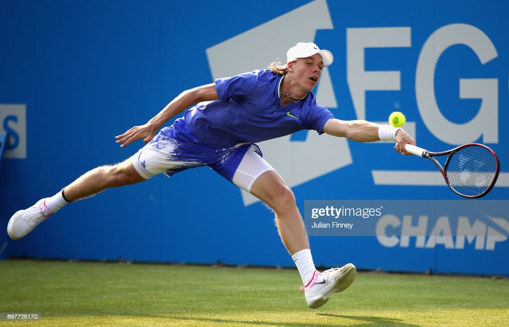 Denis Shapovalov of Canada plays a forehand during the mens singles first round match against Kyle Edmund of Great Britain during day one of the 2017 Aegon Championships at Queens Club on June 19, 2017 in London, England.