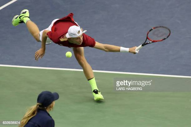 Denis Shapovalov of Canada reaches for a ball against Kyle Edmund of Great Britain during the first set on the third day of Davis Cup first round...