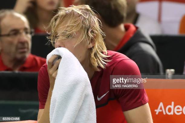 Denis Shapovalov of Canada reacts after accidentaly hitting the head refereeArnaud Gabas from France during third set action against Kyle Edmund of...