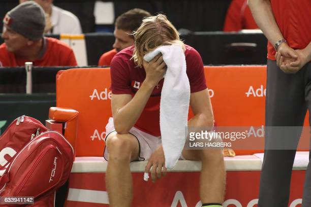 Denis Shapovalov of Canada reacts after hitting the head referee during the thirs et action by accident on the third day of Davis Cup first round...