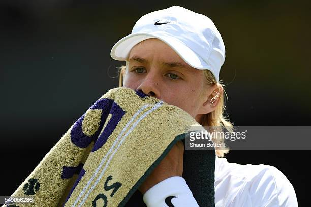 Denis Shapovalov of Canada reacts against Finn Bass of Great Britain on day eight of the Wimbledon Lawn Tennis Championships at the All England Lawn...