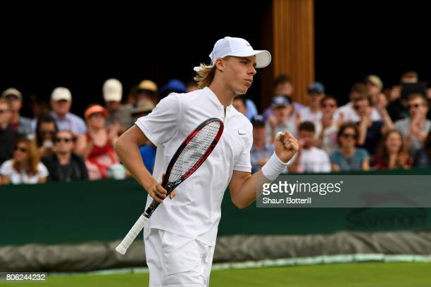 Denis Shapovalov of Canada reacts during the Gentlemen's Singles first round match against Jerzy Janowicz of Poland on day one of the Wimbledon Lawn...