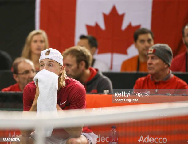 Denis Shapovalov of Canada reacts to hitting chair umpire Arnaud Gabas in the eye with a ball and forfeiting the the singles match against Kyle...