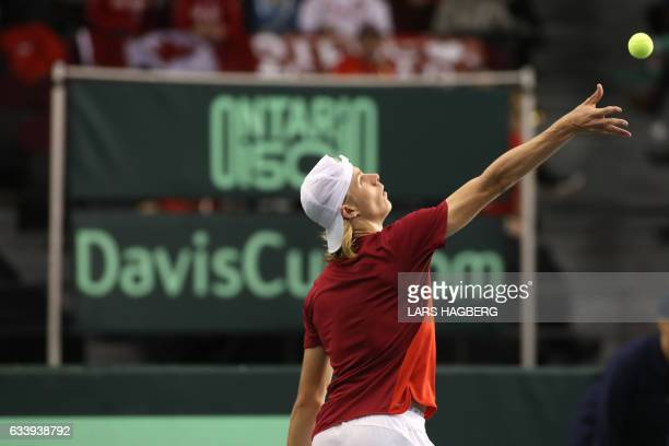 Denis Shapovalov of Canada serves against Kyle Edmund of Great Britain during the second set on the third day of Davis Cup first round between Canada...