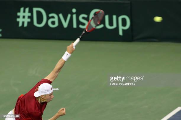 Denis Shapovalov of Canada serves against Kyle Edmund of Great Britain during the first set on the third day of Davis Cup first round play between...