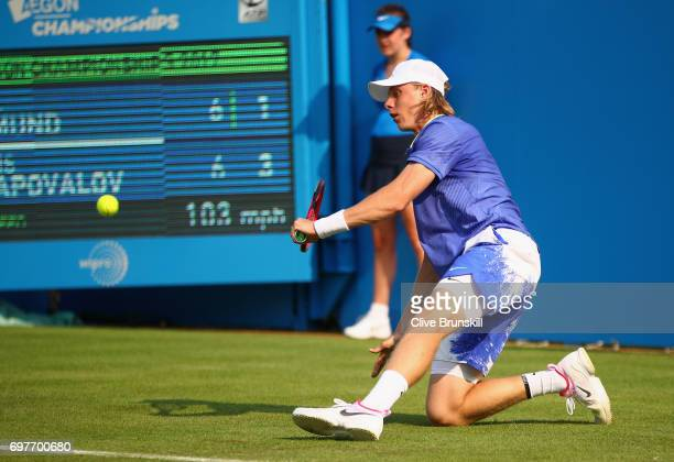 Denis Shapovalov of Canada slips and returns the ball during the mens singles first round match against Kyle Edmund of Great Britain during day one...