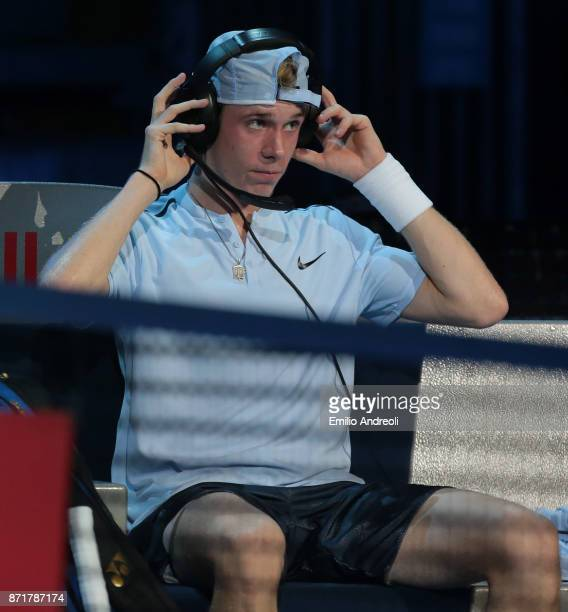 Denis Shapovalov of Canada speaks with his coach during time out through the headphones in his match against Gianluigi Quinzi of Italy during Day 2...