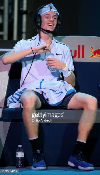 Denis Shapovalov of Canada speaks with his coach during time out through the headphones in his match against Andrey Rublev of Russia during Day 3 of...
