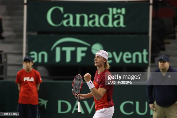 Denis Shapovalov of Canada wins a point against Kyle Edmund of Great Britain during the second set on the third day of Davis Cup first round play...