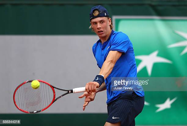 Denis Shapovalov of Russia hits a forehand during the Boys Singles first round match against Maxence Broville of France on day eight of the 2016...