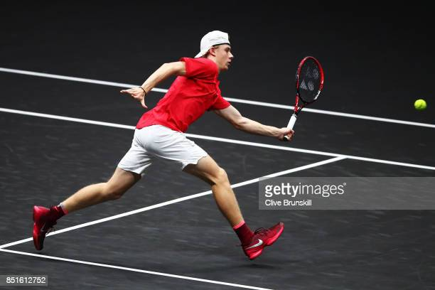 Denis Shapovalov of Team World plays a volley during his singles match against Alexander Zverev of Team Europe serevs on the first day of the Laver...