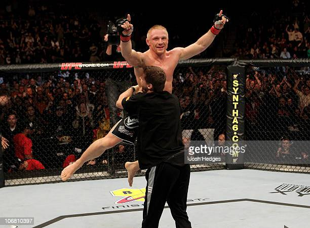 Denis Siver of Germany celebrates his victory by tap out in the 1st round over Andre Winner of England during their UFC Lightweight bout at the Konig...