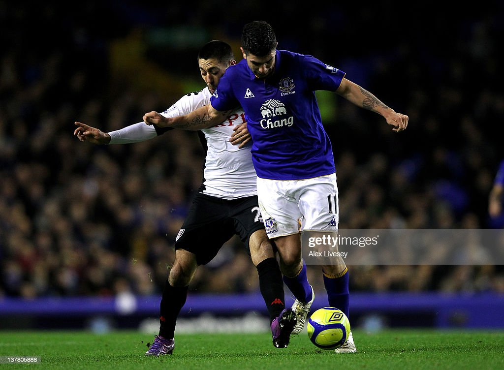 Denis Stracqualursi of Everton is challenged by <a gi-track='captionPersonalityLinkClicked' href=/galleries/search?phrase=Clint+Dempsey&family=editorial&specificpeople=547866 ng-click='$event.stopPropagation()'>Clint Dempsey</a> of Fulham during the FA Cup Fourth Round match between Everton and Fulham at Goodison Park on January 27, 2012 in Liverpool, England.