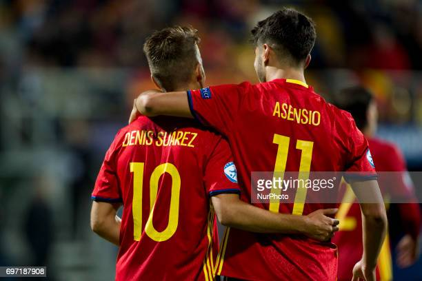 Denis Suarez and Marco Assencio of Spain celebrate after goal during the UEFA Under 21 Championship Group B match between Spain and FYR Macedonia at...