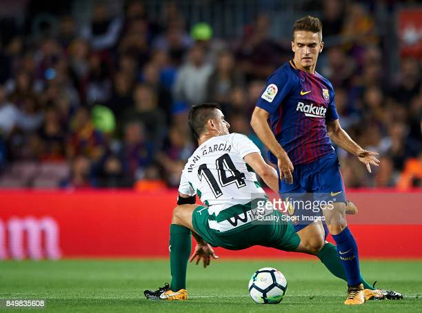 Denis Suarez of Barcelona competes for the ball with Dani Garcia of Eibar during the La Liga match between Barcelona and Eibar at Camp Nou on...