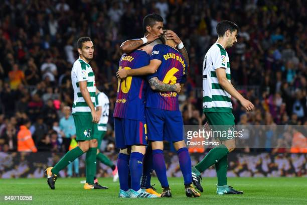 Denis Suarez of FC Barcelona celebrates with bis team mates Lionel Messi and Paulinho of FC Barcelona after scoring his team's third goal during the...