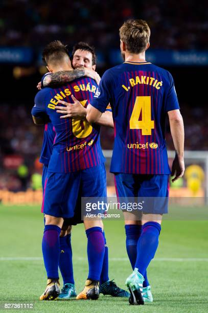 Denis Suarez of FC Barcelona celebrates with his teammates Lionel Messi and Ivan Rakitic after scoring his team's fifth goal during the Joan Gamper...