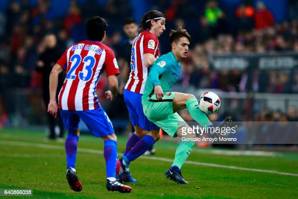 Denis Suarez of FC Barcelona competes for the ball with Filipe Luis of Atletico de Madrid and his teammate Nicolas Gaitan during the Copa del Rey...