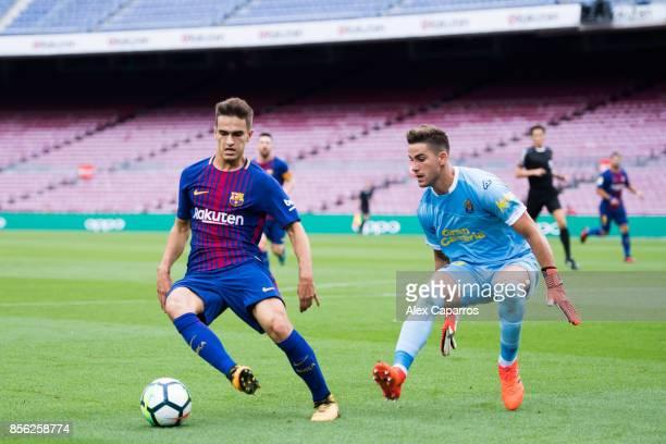 Denis Suarez of FC Barcelona dribbles Leandro Chichizola of UD Las Palmas during the La Liga match between Barcelona and Las Palmas at Camp Nou on...