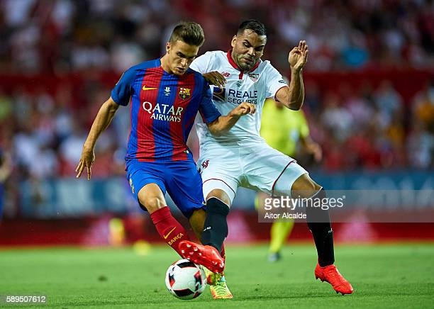 Denis Suarez of FC Barcelona is challenged by Gabriel Mercado of Sevilla FC during the match between Sevilla FC vs FC Barcelona as part of the...