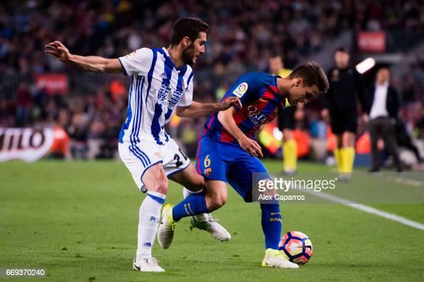 Denis Suarez of FC Barcelona protects the ball from Joseba Zaldua of Real Sociedad de Futbol during the La Liga match between FC Barcelona and Real...