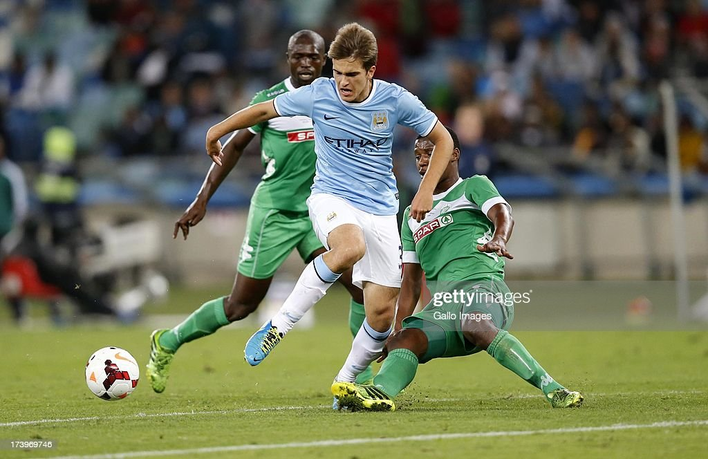 Denis Suarez of Manchester City beats the Amazulu defense during the Nelson Mandela Football Invitational match between AmaZulu and Manchester City at Moses Mabhida Stadium on July 18, 2013 in Durban, South Africa.