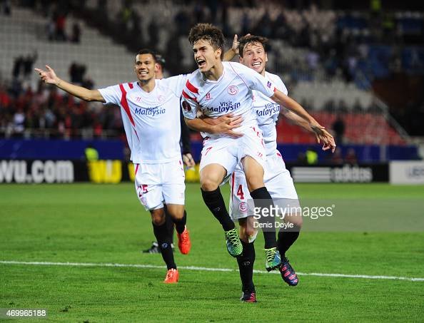 Denis Suarez of Sevilla celebrates with team mates as he scores their second goal during the UEFA Europa League Quarter Final first leg match between...