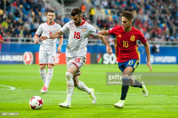 Denis Suarez of Spain fights for the ball with Egzon Bejtulal of Macedonia during the UEFA Under 21 Championship Group B match between Spain and FYR...