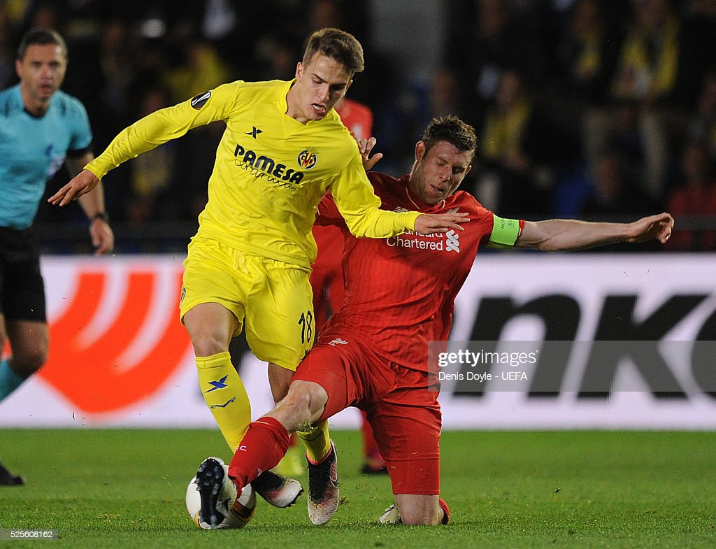 Denis Suarez of Villarreal CF is tackled by James Milner of Liverpool during the Europa League Semi Final first leg match between Villarreal CF and Liverpool at El Madrigal stadium on April 28, 2016 in Villarreal, Spain.